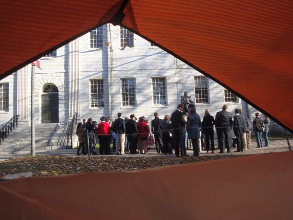 Some tour groups -- such as the one viewed here from inside a tent -- are still being allowed inside the Yard when accompanied by Harvard guides. (Blast Staff photo/John Stephen Dwyer)